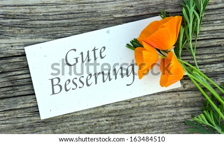 white card with poppy/Get well/german
