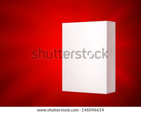 White cardboard box on a red background with copy space. Clipping path included - stock photo