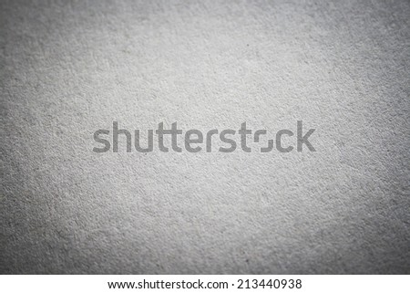 white cardboard texture or background with dark vignette borders - stock photo