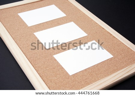 white cards on a corkboard