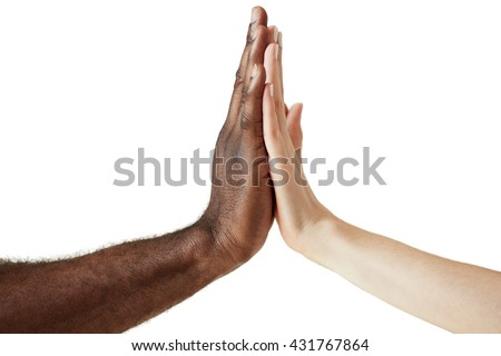 White Caucasian female and black African American male holding hands together in world unity, racial love and understanding concept. Close up shot of two people of different cultures giving five. - stock photo