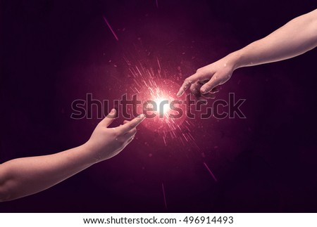 White caucasian male hands reaching out with fingers almost touching in bright red light sparkle in empty space background concept