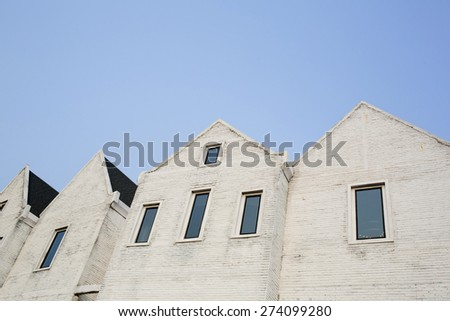 White cement brick block wall with a narrow window