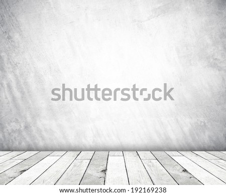 White cement wall and old wood floor, empty perspective room in light tone. - stock photo
