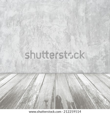 White cement wall and old wood floor, perspective view.
