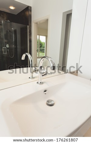 White ceramic bathroom sink and silver tap