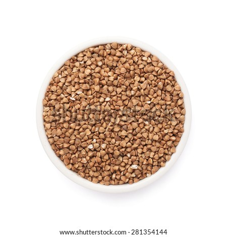 White ceramic bowl full of the buckwheat seeds isolated over the white background, top view above foreshortening - stock photo