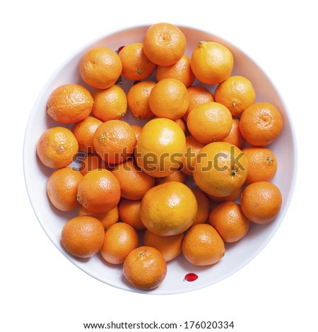White ceramic bowl of oranges, tangerines, and clementines - stock photo