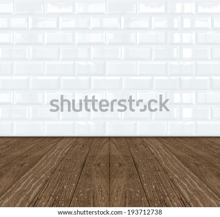 White Ceramic brick tile wall and dark wooden floor - stock photo