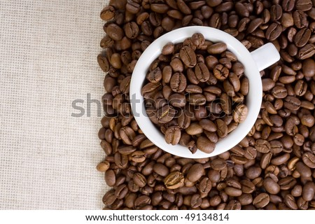 white ceramic cup, coffee and textile