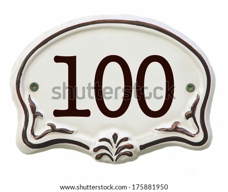 White ceramic decorated tile showing the number 100 - stock photo