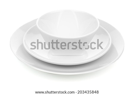 White ceramic dish set with plates and bowl over white - stock photo