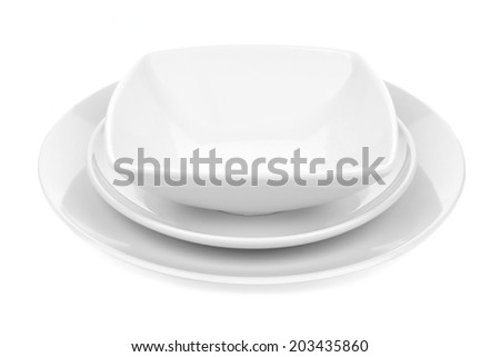 White ceramic dish set with plates and rounded square bowl over white - stock photo