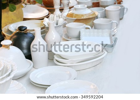 white ceramic kitchenware ,tableware plates mugs shabby chic retro vintage tenderness, Clean plates, ceramic industrial and ceramic shop. - stock photo