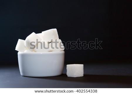 White ceramic sugar bowl on dark background - stock photo