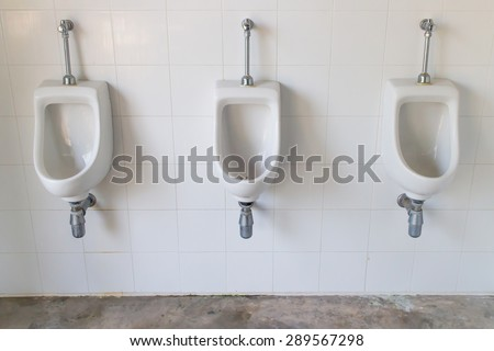white ceramic urinals for men - stock photo