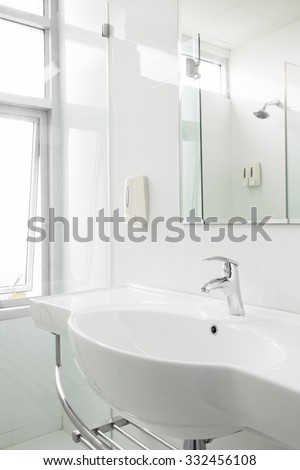 white ceramic washbasin in hygienic condition restroom. - stock photo
