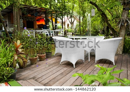 white chair in the garden - stock photo