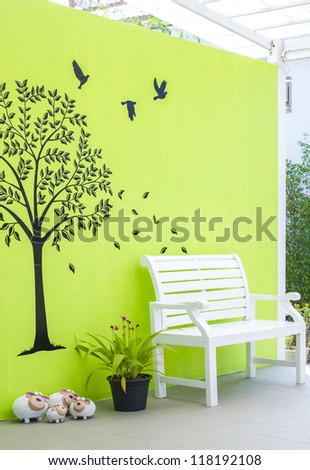 white chair with lovely wall