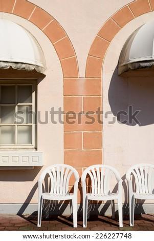 white chairs on street  - stock photo
