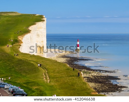 White chalk cliffs and Beachy Head Lighthouse. Eastbourne, East Sussex, England. Selective focus - stock photo