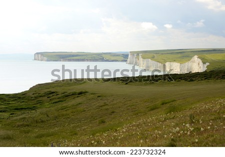 White Chalk Cliffs the Seven Sisters viewed from Beachy Head near Eastbourne in East Sussex. England - stock photo