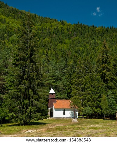 White chapel in the mountains