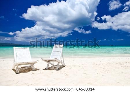 White chears at perfect tropical beach resort. Boracay, Philippines. - stock photo