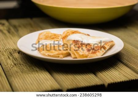 White cheese pancakes with cream - stock photo