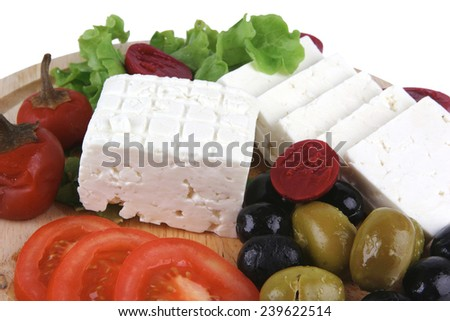 white cheese served on plate with vegetables - stock photo
