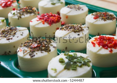 white cheese snack with various fine herbs and spices