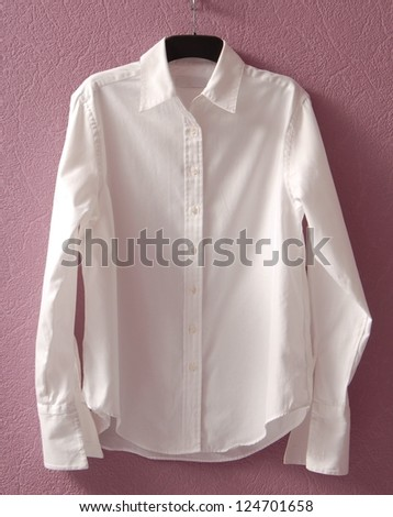 White chemise is on hanger. - stock photo