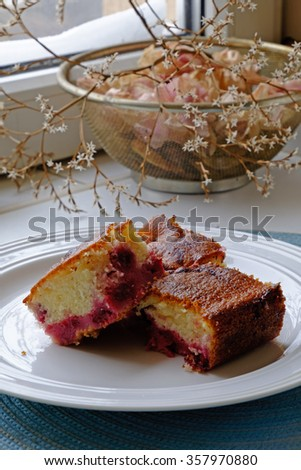 White cherry cake slices on a white ceramic plate in tight portrait