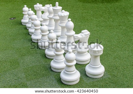 white chess figure on glass - stock photo