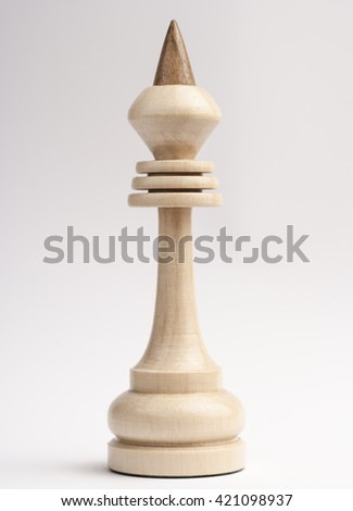 White chess king on a gray background.