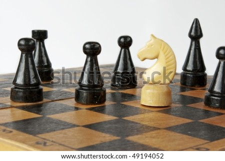 white chess knight and black enemy