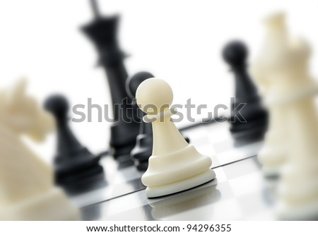 White chess pawn. In an environment of other figures. Selective focus - stock photo