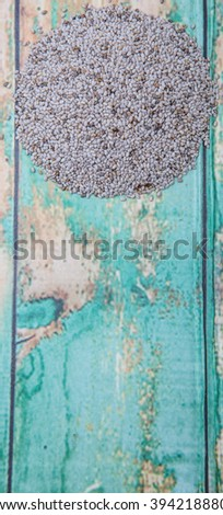 White chia seed over wooden background