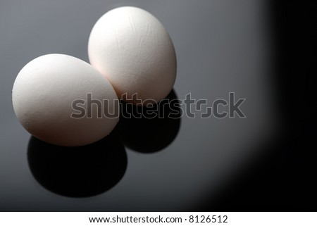White Chicken Eggs on Black Background