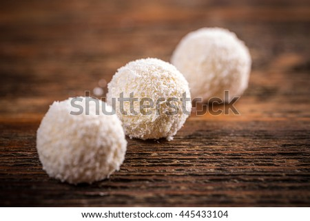 White chocolate candy coconut truffles in row - stock photo