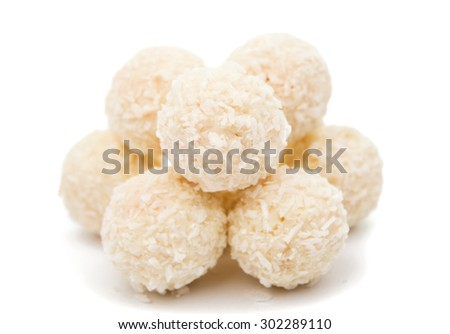 White Chocolate Candy With Coconut Topping On White Background - stock photo