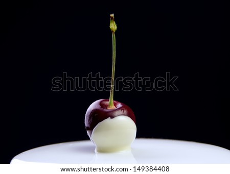 White chocolate-dipped cherry. - stock photo