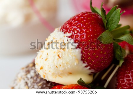 White chocolate dipped strawberry close-up coated in coconut - stock photo