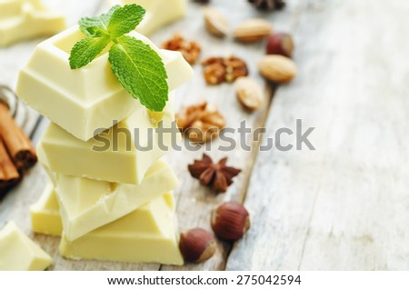 white chocolate on a white wood background. the toning. selective focus - stock photo