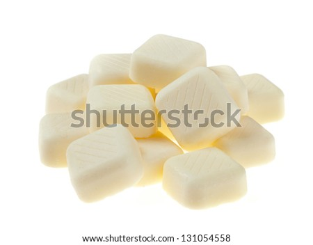 White chocolate pieces isolated on white background. - stock photo