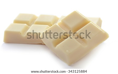 White chocolate pieces isolated on white background - stock photo