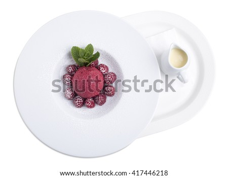 White chocolate soup with ice cream scoop and fresh raspberries. Isolated on a white background.