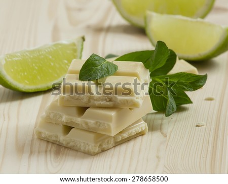 White chocolate with mint and lime, selective focus