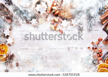 White Christmas Background with empty copy space. Cakes and nuts as a decorative xmas frame for xmas concept or cards - stock photo