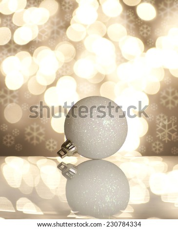 White Christmas ball in the snow on a beautiful bokeh background. - stock photo